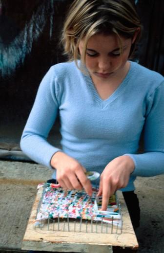 Stock Photo: 1566-017608 Girl making handicrafts