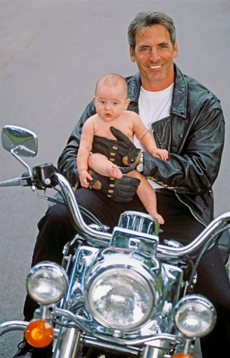 Stock Photo: 1566-0177967 Father and baby on motorbike