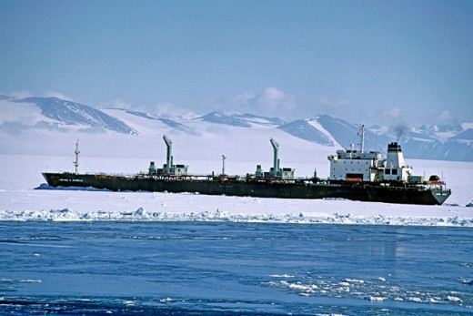 Tanker in ice to refuel McMurdo station: it arrives once a year for the years supply of fuel, Antarctica : Stock Photo