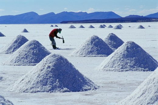 Salt extraction. Salar de Uyuni (Uyuni salt flat). Bolivia : Stock Photo