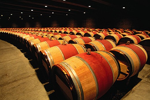 Stock Photo: 1566-0181747 Wine oak casks in a cellar. Opus One Winery. Napa Valley. California. USA