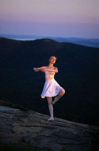 Ballet dancer on mountain : Stock Photo