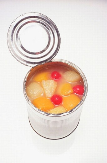 Mixed canned fruit: peaches, pears and cherries : Stock Photo