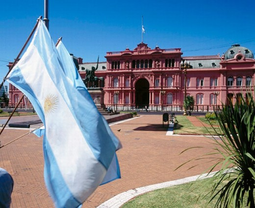 Casa Rosada, presidential palace and Argentinian flags at Plaza de Mayo. Buenos Aires. Argentina : Stock Photo