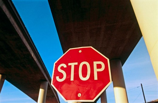 Stop sign under freeway over pass. San Francisco. California. USA : Stock Photo