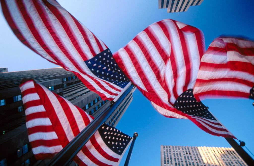 Stock Photo: 1566-0195183 American flags and Rockefeller Center, New York City. USA