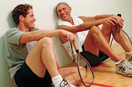 racket ball player relax/chatting between games : Stock Photo