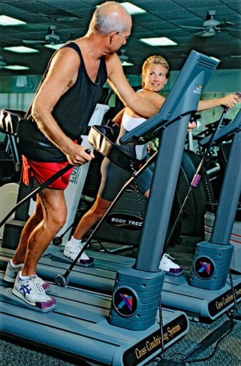 Stock Photo: 1566-0195746 couple working out in at a health club