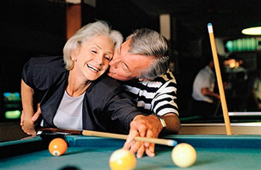 senior couple shooting pool : Stock Photo