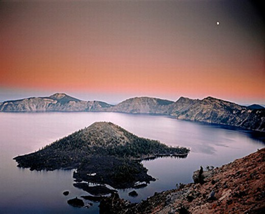 Moon over Crater Lake and Wizard Island at twilight. Crater Lake National Park. Oregon. USA. : Stock Photo