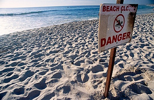 Stock Photo: 1566-0197606 A well used beach closed sign. Cottesloe beach, closed because of sharks in the water. Western Australia. Indian ocean