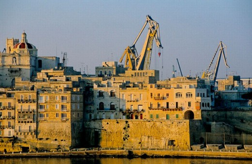 Stock Photo: 1566-0198796 Valletta ramparts seen from the MS Sapphire deck when arriving at sunrise. Malta.