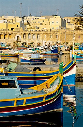 Stock Photo: 1566-0198853 Local fishing boats or Luzzu, decorated with Osiris eyes for good luck. Marsaxlokk. Malta.