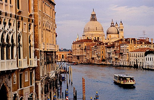 Stock Photo: 1566-0198890 La Salute church at back. The Grand Canal at dusk. Venice. Italy.