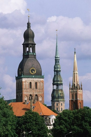 Stock Photo: 1566-0204979 Church towers in Riga: (left to right) Cathedral, Anglican Church and St. Peter´s Church old town from Vansu bridge on Daugava river. Riga, Latvia