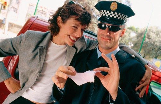 Policeman tearing up a traffic ticket : Stock Photo