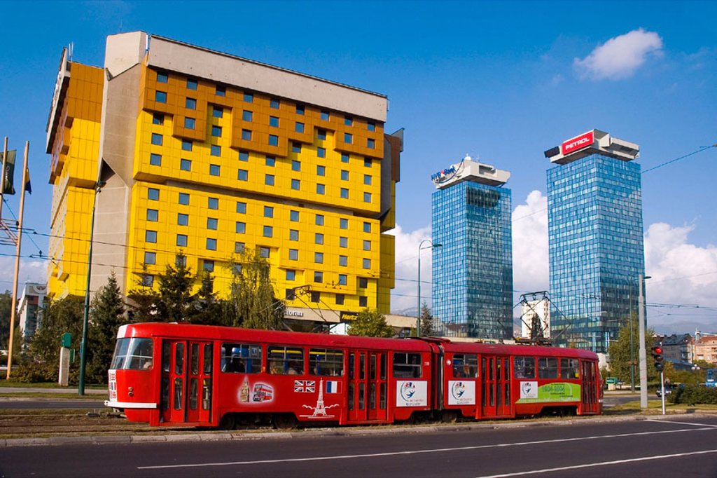Stock Photo: 1566-0206604 Bosnia-Herzegovina, Sarajevo, Holiday Inn and red tram on Sniper´s Alley