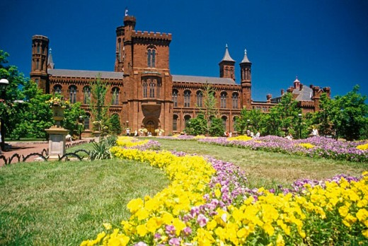 Stock Photo: 1566-0209007 Smithsonian Institution Building and gardens (´The Castle´, James Renwick Jr., 1855), constructed in the Norman style -a 12th-century combination of late Romanesque and early Gothic motifs-. Washington D.C. USA