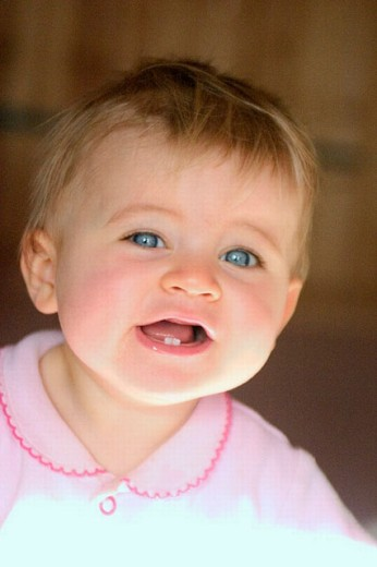 10 month old baby girl smiling : Stock Photo