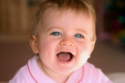 Stock Photo: 1566-0214741 10 month old baby girl laughing