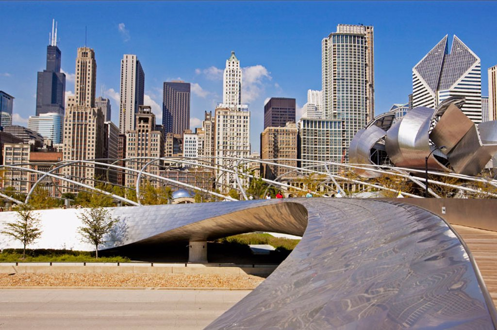 Stock Photo: 1566-0215031 BP Bridge, Frank Gehry design, in Millennium Park, skyline, stainless steel curves. Chicago. Illinois. USA