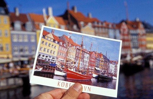 Nyhavn, translated the New Harbor, noted for it´s colorful houses, is a very popular place, with many restaurants and pubs: the area is one of the main tourist attractions. Copenhagen. Denmark : Stock Photo