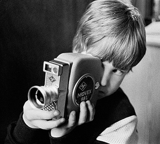 Stock Photo: 1566-0216896 You boy playing with film camera, Sweden