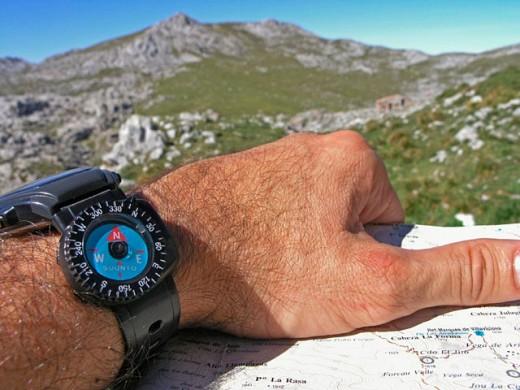 Reading a map. Vega de Ario. Wester Massif. Picos de Europa National Park. Biosphere Reserve. Asturias. Spain : Stock Photo