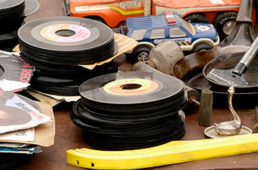Items for sale at Flea Market in the Midwestern part of the USA, 45 speed records, toys, etc. : Stock Photo