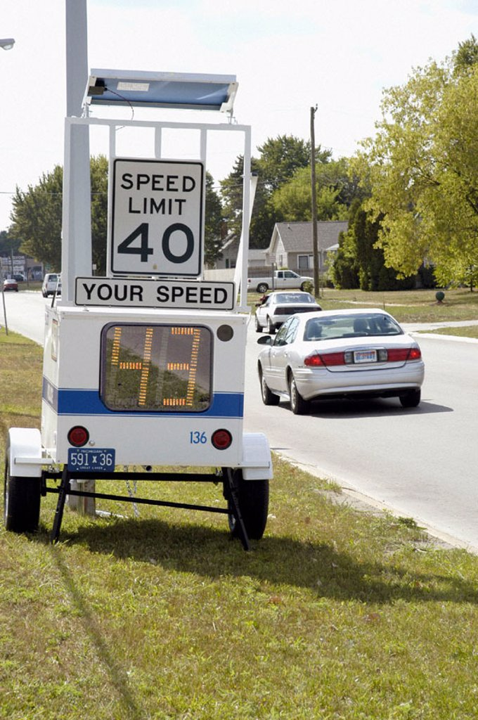 Stock Photo: 1566-0219683 Speed sign shows drivers their speed in an attempt to slow speed of traffic.