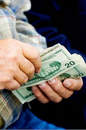 Stock Photo: 1566-0219974 Man with money in his hands