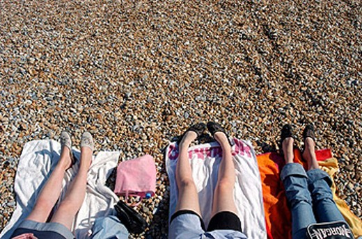 Young women legs on a beach : Stock Photo