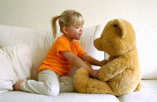 Girl with Teddy bear : Stock Photo