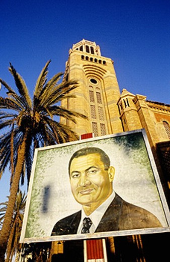 The cathedral and poster of President Mubarak. Port Said at the mediterranean entrance of the Suez canal. Egypt : Stock Photo