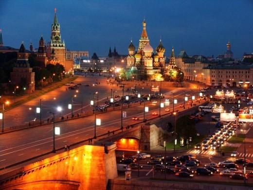 Moscow, Russia, Kremlevskaya Nab, Kremlin Walls, Neva River, at twilight, with traffic, rush hour, car light streaks. : Stock Photo
