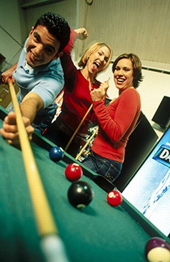 College students play pool. : Stock Photo
