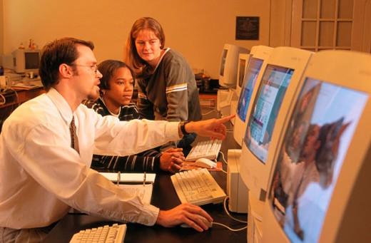 Stock Photo: 1566-023154 College professor wirh students in computer laboratory. Tennessee. USA