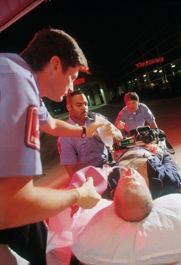 Stock Photo: 1566-0232410 Paramedics rushing patient to emergency in hospital