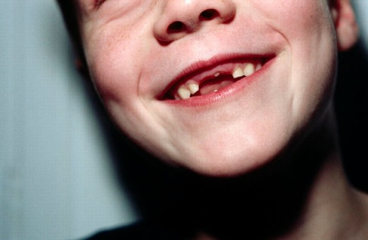 Seven year old boy with gap between teeth. Germany. : Stock Photo