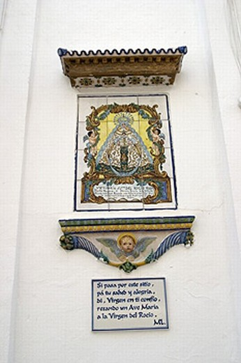 Stock Photo: 1566-0236238 Temple and Casa de Hermandad of the Virgen del Rocío. Ceramic figure and inscription on the outer wall. Sanlúcar de Barrameda, Cádiz province. Andalusia. Spain