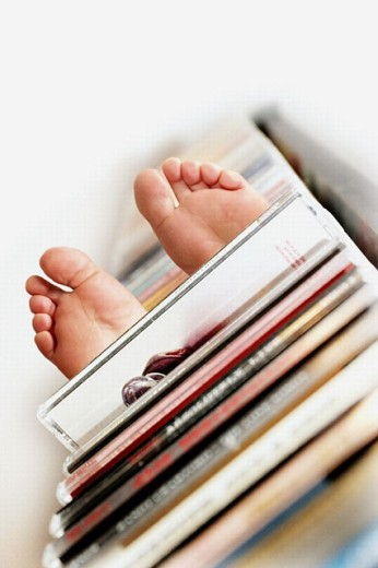 Digital composite of feet and CD stand : Stock Photo