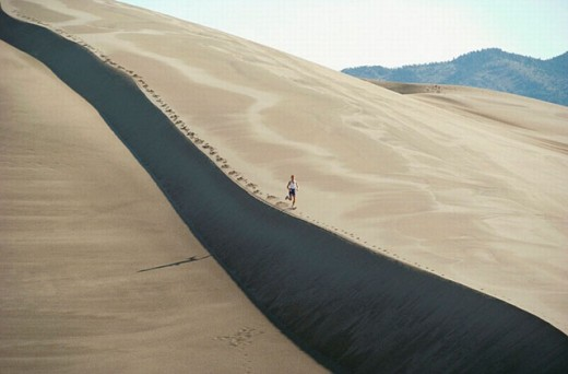 Woman running, Great Sand Dunes National Monument near Alamosa. Colorado, USA : Stock Photo
