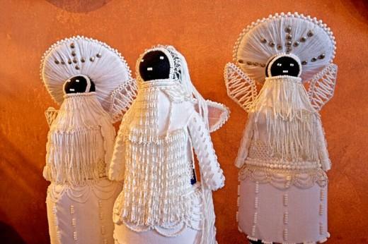 Zulu puppets representing angels. Bat Shop Gallery exhibiting zulu artists work. Owner Marisa Fick-Jordaan. Bayside. Durban. Kwazulu-Natal province. South Africa : Stock Photo