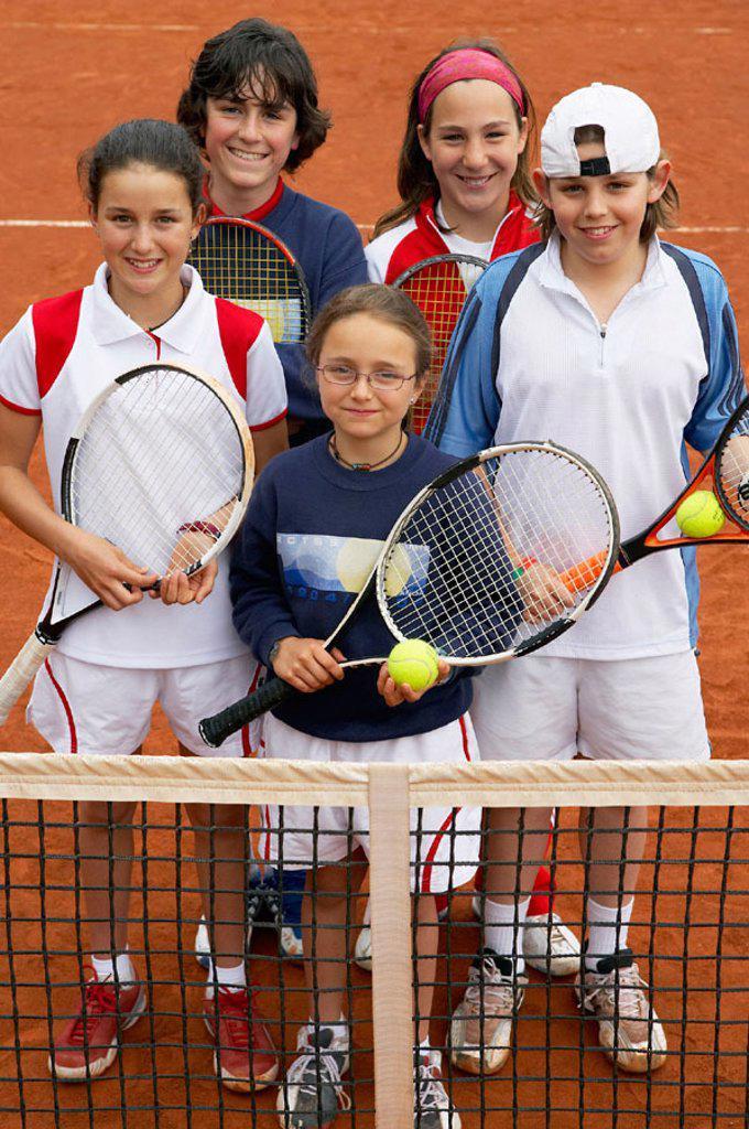 Stock Photo: 1566-0239344 10-15 year old children in clay court, tennis school. Royal Tennis Club of San Sebastian, Euskadi, USA