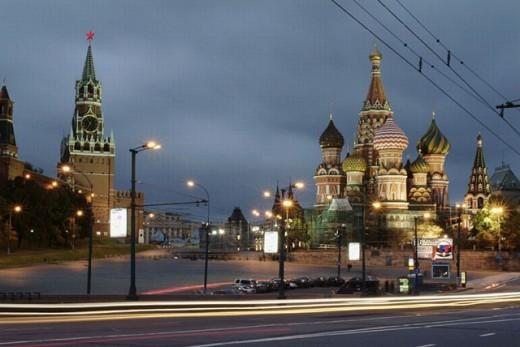 Stock Photo: 1566-0239865 Moscow, Russia, Kremlevskaya Nab, Kremlin Walls, at twilight, with traffic, rush hour, car light streaks.