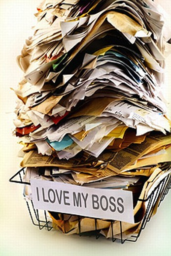 Stacked papers in tray, ´I love my boss´ label : Stock Photo