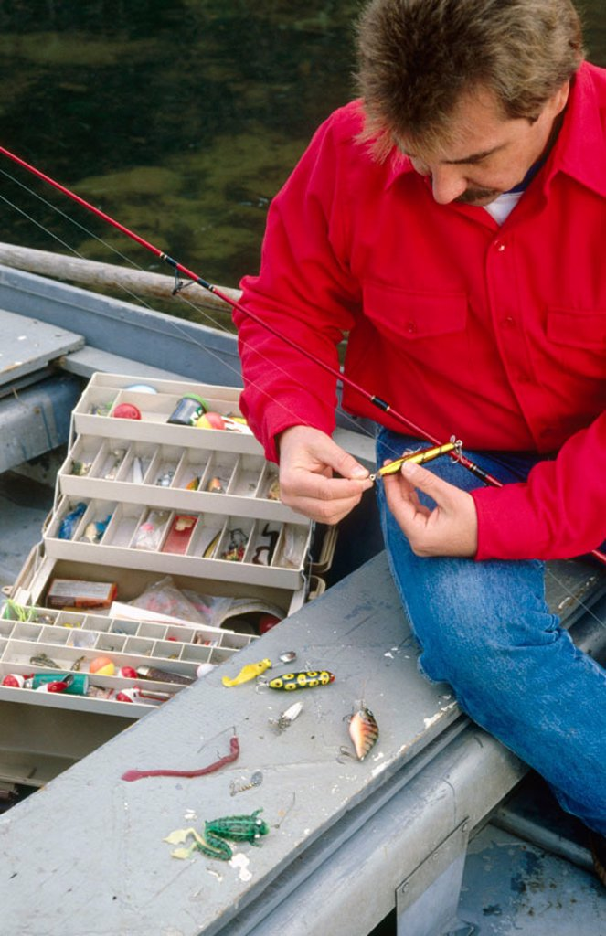 Stock Photo: 1566-0243784 Tackle box with lures