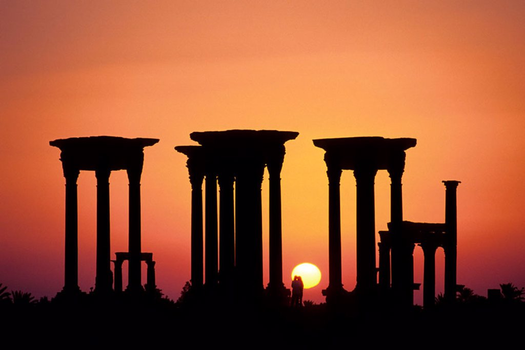 Stock Photo: 1566-0246779 Sunrise. Tetrapylon. Palmyra. Syria.