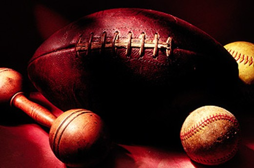 Football, baseball, softball and dumbbell still life : Stock Photo