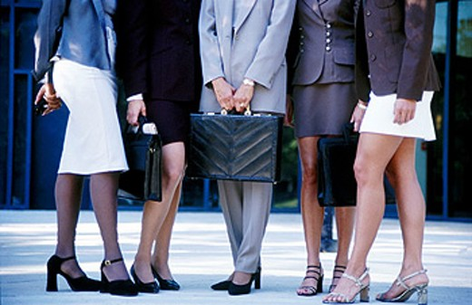 Businesswomen in various attire : Stock Photo